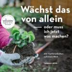 Cover: Behandschuhte Hand hält eine Erdbeerpflanze